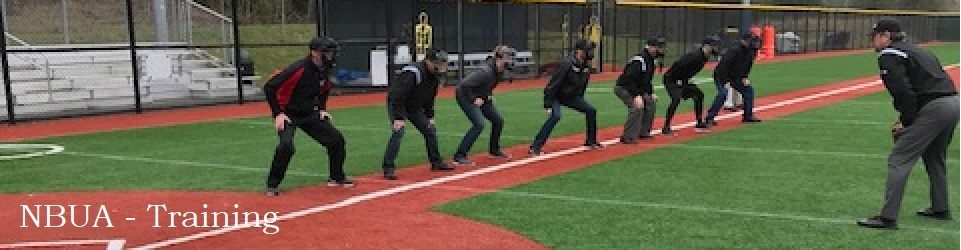 line of new umpires practicing their stance